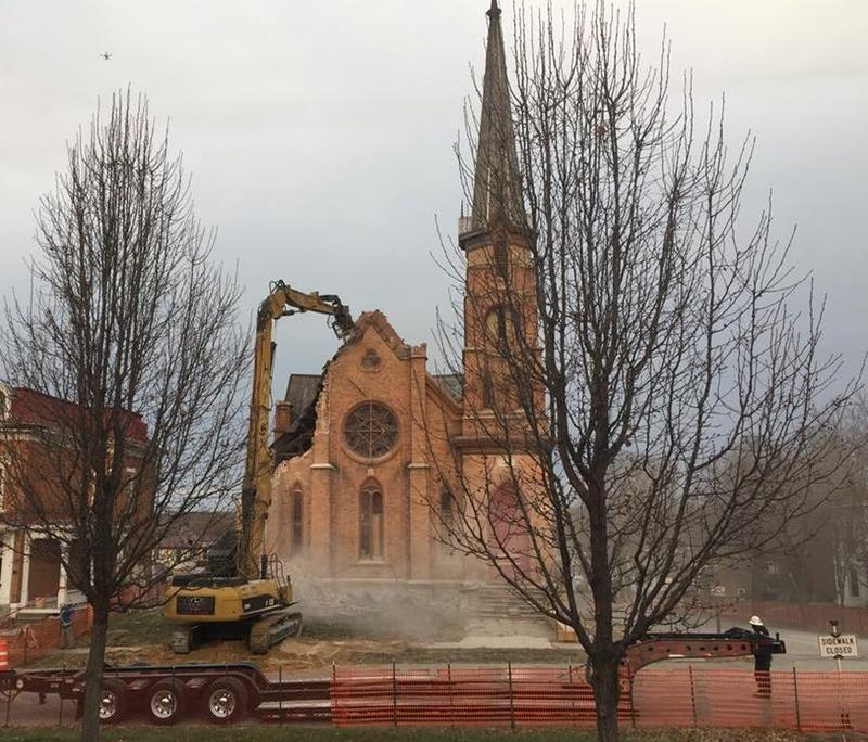 The large, metal claw was slowly crunching the bricks on one corner of the church at 8:20 Wednesday morning.
