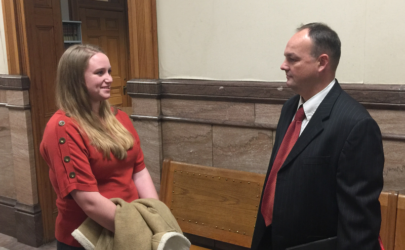 Cheyenne Jerred (L) consults with her attorney, Curtis Dial, following Monday's debtor's examination in Keokuk. Jerred won a nearly $750,000 settlement against her former employer, Midwest Academy, for wrongful termination.
