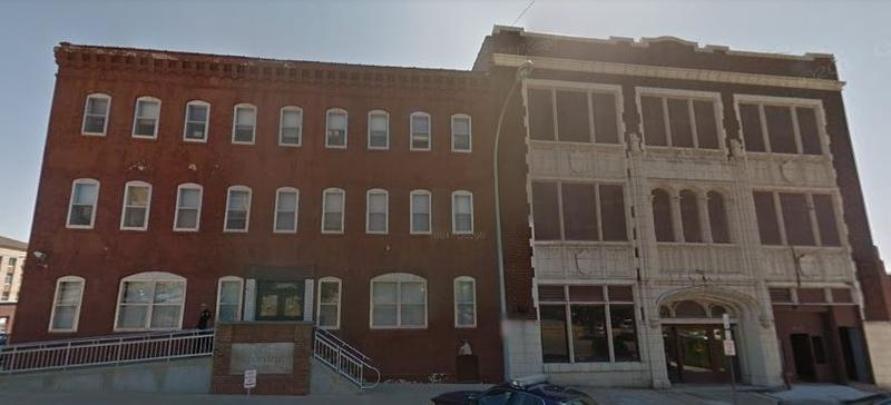 The Burlington Police Station (L) would be demolished and the building on the right would be rehabbed and expanded into a downtown hotel.
