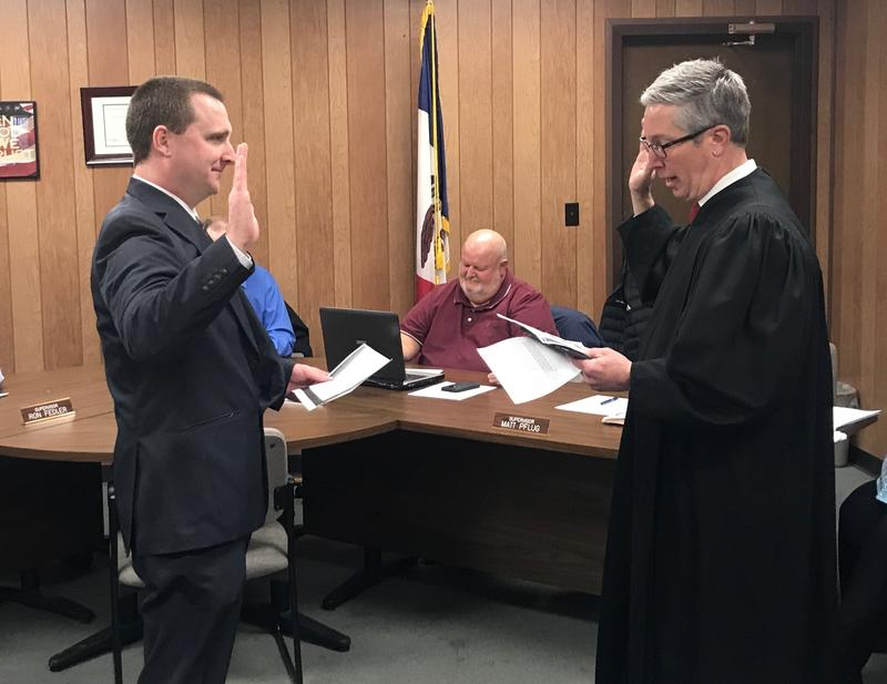 District Court Judge John Wright (R) administers the oath of office to newly appointed Lee County Sheriff Ross Braden Tuesday morning in Fort Madison.