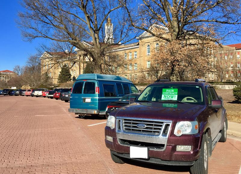 "A truck parked in front of WIU's Sherman Hall displays union sponsored poster that reads, ""fair contract now"""