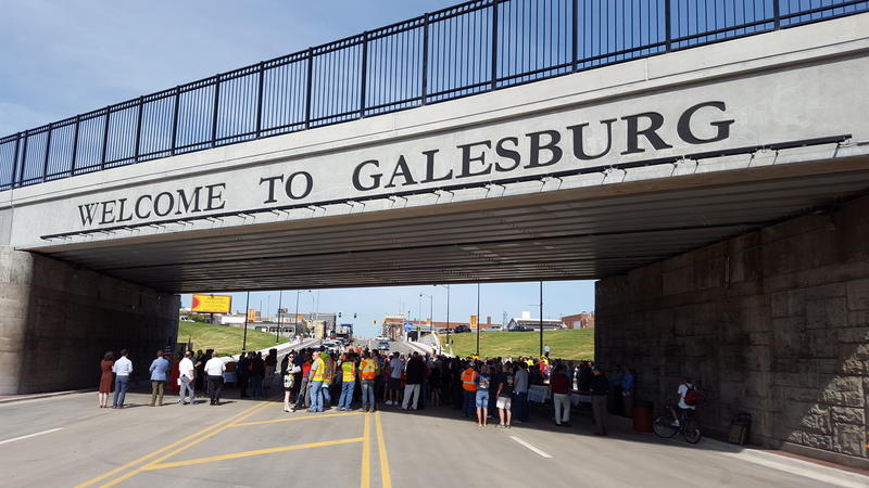 Hundreds of people gathered in the shade of the underpass for the grand opening ceremonies.