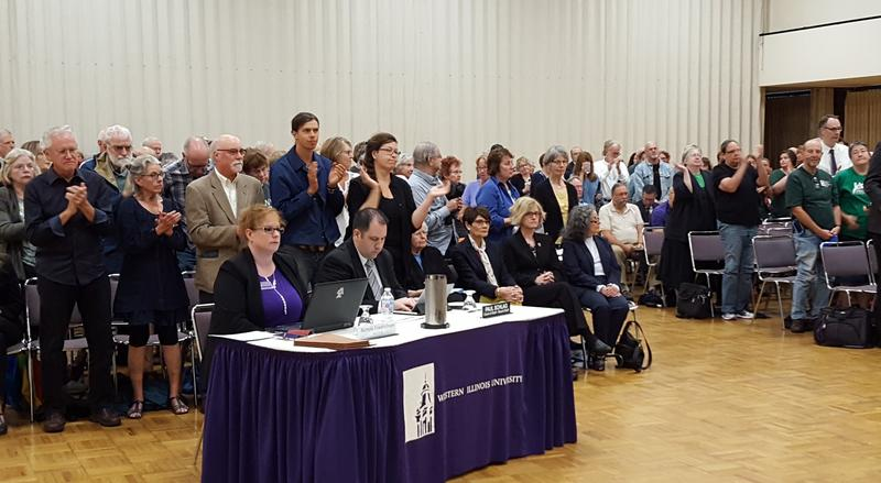 """Most of the crowd stood and applauded as people called out, """"I stand with Tri States Public Radio!"""""""
