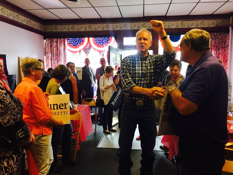 Governor Rauner shakes hands with attendees as he enters the McDonough County Republican Headquarters