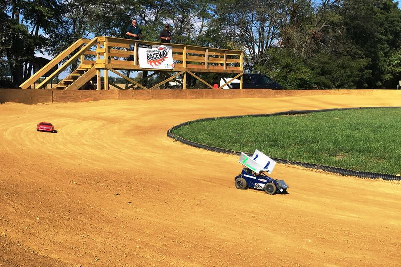 Jason Miller (left) and Larry Wright (right) on the driver's stand racing their rc cars