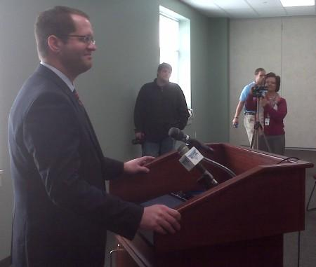 Curtis Oldfield takes the podium during the announcement at the SRC Community Outreach Center in Macomb