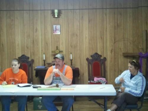 Alderwoman Tonya Putnam (L), Mayor Tom Allen, and Alderwoman DiAnna Allen participate in the final city council meeting for Mount Sterling.