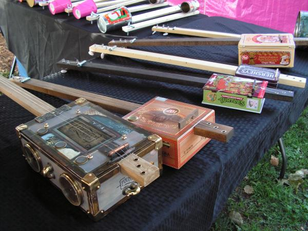 John draws makes guitars from old cigar boxes, tin cans, and a other re-purposed materials.
