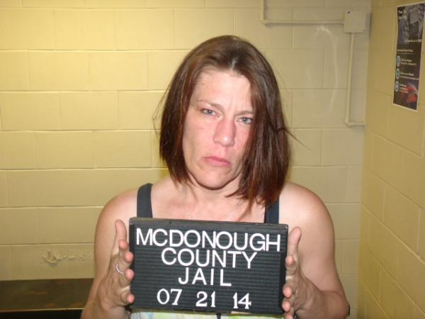 Randi Rouse is charged with Possession of Meth under 5 Grams, Possession of a Firearm without an FOID card, Possession of Drug Paraphernalia, and Possession of Cannabis 2.5 to 19 Grams.