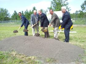 Officials from JAA and Flightstar break ground on a new hangar at Cecil Airport.