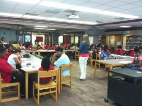 I'm A S.T.A.R. students learn about college scholarships at a recent meeting.