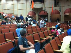 People wait for their turn at the mic to weigh in on the name change issue.  (Mandarin High School auditorium)