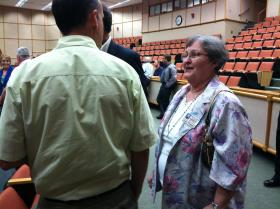 Forrest HS alum Joan Cooper chats with fellow supporters after the town hall meeting.