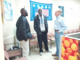 U.S. Senator Bill Nelson meets with two veterans at the Clara White Veterans Center on Thursday.