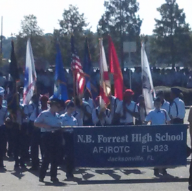 Students of Nathan Bedford Forrest High school prepare to march in Jacksonville's 2013 Veterans Day Parade, Nov. 11, 2013.