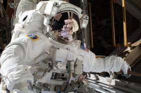 "On Sunday, Dec. 22, NASA astronaut Mike Hopkins tweeted this photo of Saturday's spacewalk, saying, ""Wow... can't believe that is me yesterday. Wish I could find the words to describe the experience, truly amazing."""
