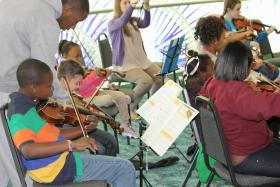 Students in Jump Start Strings rehearse for upcoming concert. The afterschool program just received a $10,000 grant.