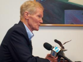 U.S. Senator Bill Nelson speaks with reporters in his Jacksonville office on Monday.