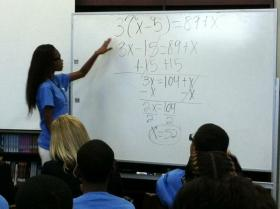 Andrew Jackson High School ninth grader Arielle Smith solves for X in Sabrina Hall's algebra one class. (Archive Photo)