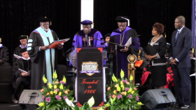 Edward Waters College Vice President of Academic Affairs Marvin Grant posthumously honors A. Philip Randolph as a Doctor of Humane Letters at commencement, May 2014.
