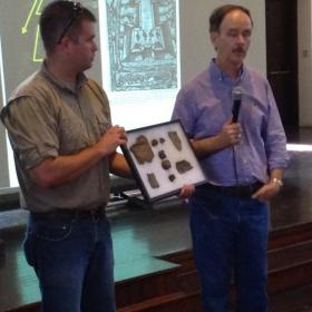 Florida Rep. Lake Ray, right, speaks as his son, Lake Ray IV, displays artifacts gathered from what they claim is the original site of Fort Caroline in Jacksonville.