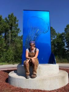 "Jenney Hager with her sculpture, ""Dance of the Jellyfish."""