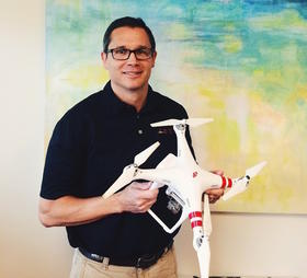 Brent Klavon, a program manager for ASEC, says inspecting crops, bridge monitoring and cell tower inspections are some examples of possibilities for commercial uses of drones like this quadcopter within Northeast Florida.
