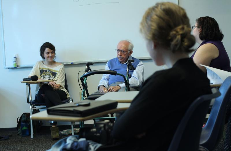 Ellie Strube (far left) and Hy Kliman (center) at the University of North Florida's ghostwriting class.
