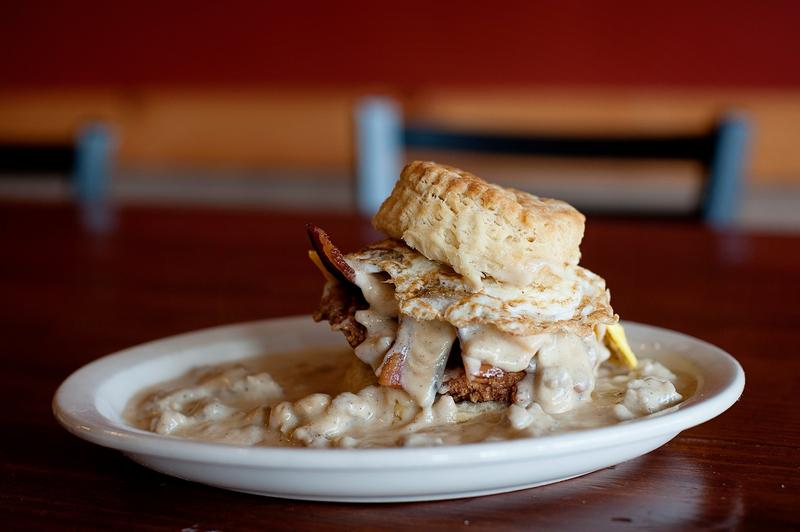 "The ""Five and Dime"" sandwhich at Maple Street Biscuit Company - fried chicken, smoked bacon, cheddar cheese topped with sausage gravy and a fried egg on a biscuit."
