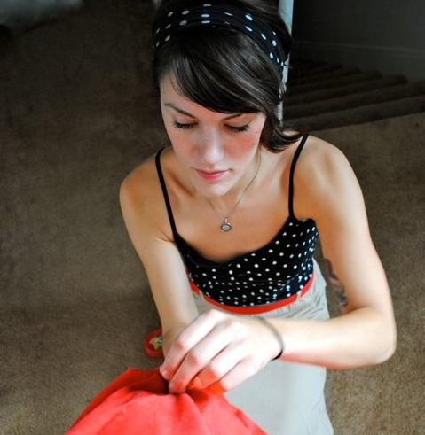 """Sally Keiser hemming a piece of clothing. Keiser will seek funding to open """"Sally Ann's Sewing Lounge"""" at this year's One Spark festival."""