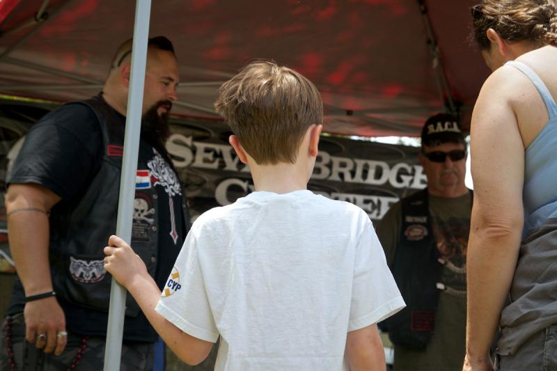 Members of BACA Seven Bridges Chapter explain their mission to attendees at Kids Day in Orange Park, Fla. on July 26, 2014.