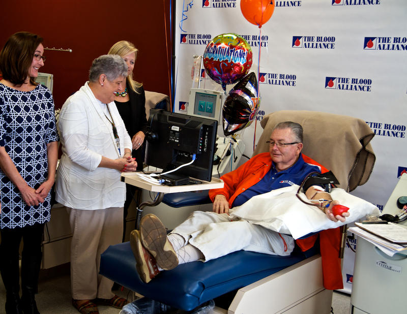 Harold Green sitting in chair donating blood