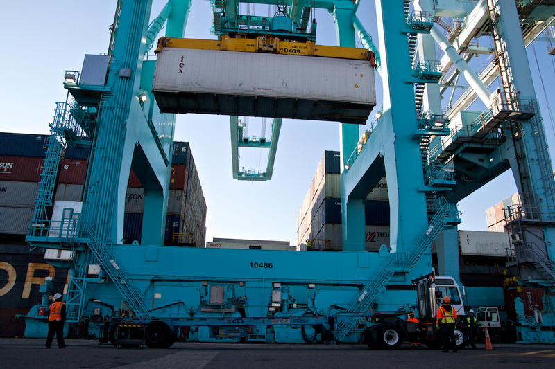 Fifty-gauge electric cranes hoist shipping containers off a Horizon Lines freighter from Puerto Rico at the Port of Jacksonville.