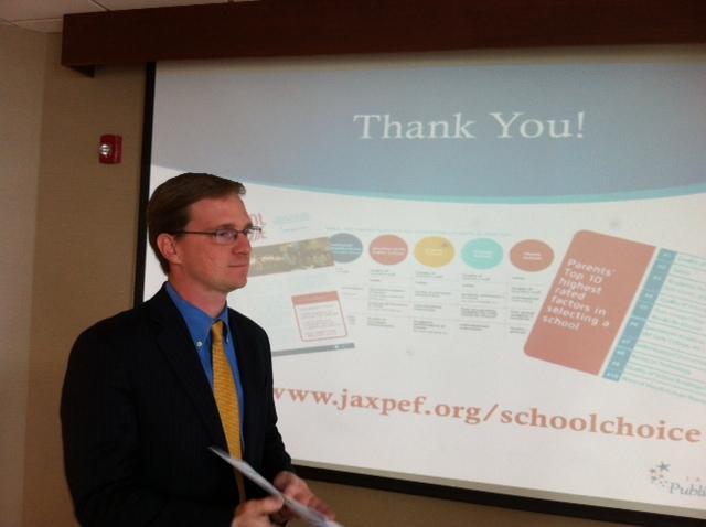 Trey Csar standing in front of presentation screen