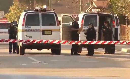 police tape and vehicles