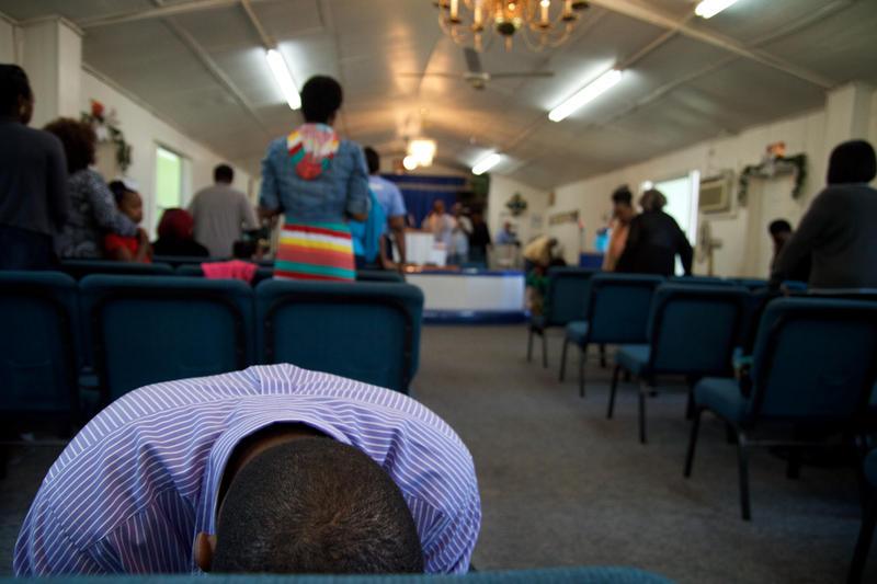 Darnell Barker prays at Glorious Bethlehem Temple.