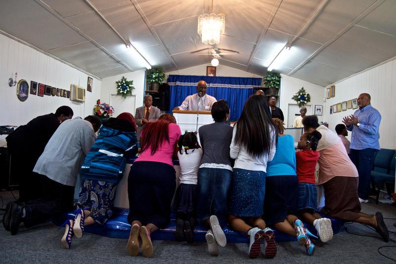 The congregation prays.