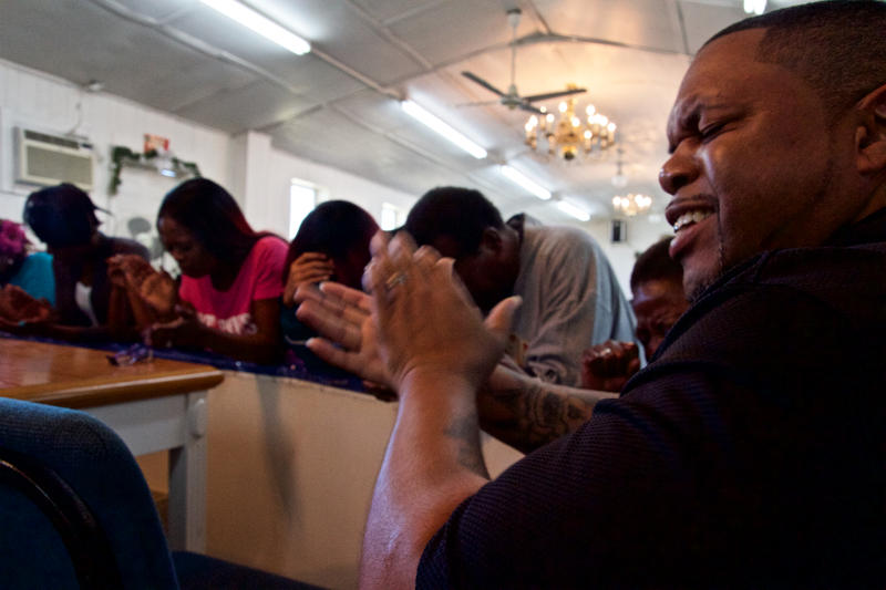 Deon Lockhart (r) unites in praise with the congregation of Glorious Bethlehem Temple in Jacksonville.