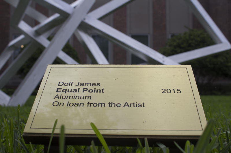 "Plaque naming the aluminum sculpture ""Equal Point."""