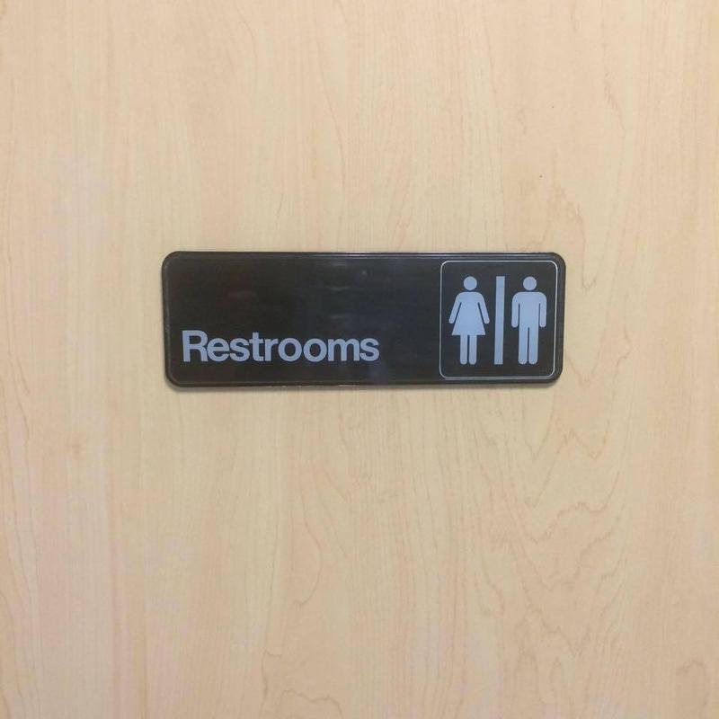 restroom door with male and female figures