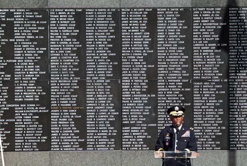 Florida National Guard Adjutant General Michael Calhoun praises the sacrifice of fallen service members at the Duval County Veterans Memorial Wall.
