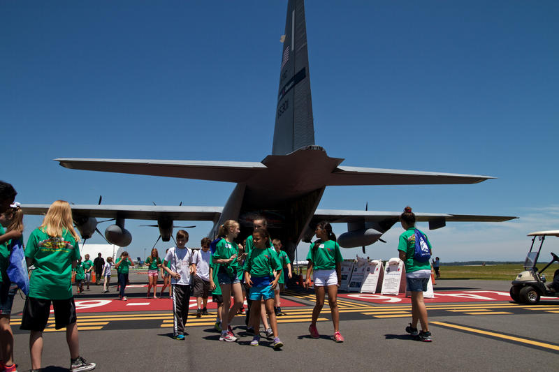 "Schoolkids visit the ""Hurricane Hunters"" crew and WC-130J aircraft at Northeast Florida Regional Airport in St. Augustine."