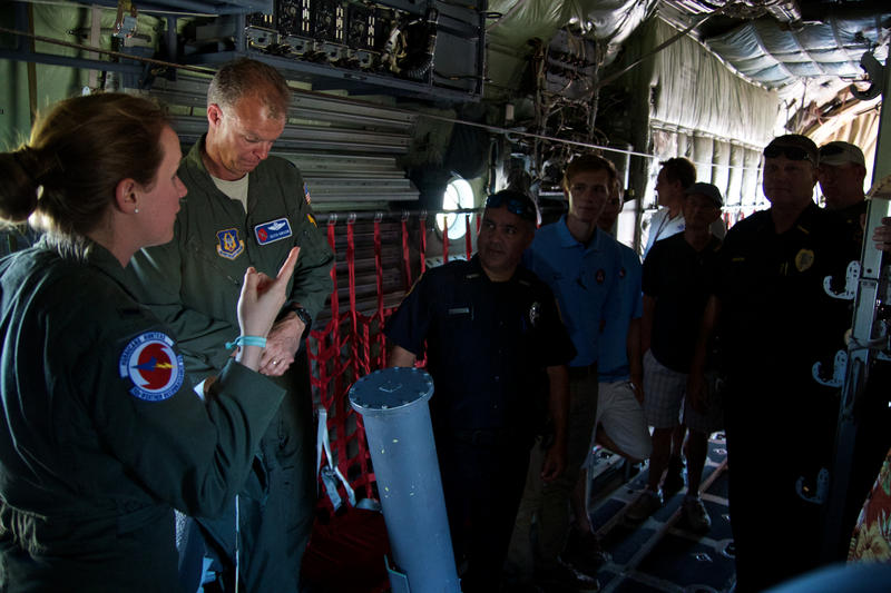 Aerial Reconnaissance Weather Officer Lisa Fralick (l) and Lt. Col. Keith Gibson answer questions about the Hurricane Hunters operations from northeast Florida first responders.