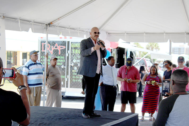 National radio host Tom Joyner speaks to the crowd at an early voting rally on Friday.