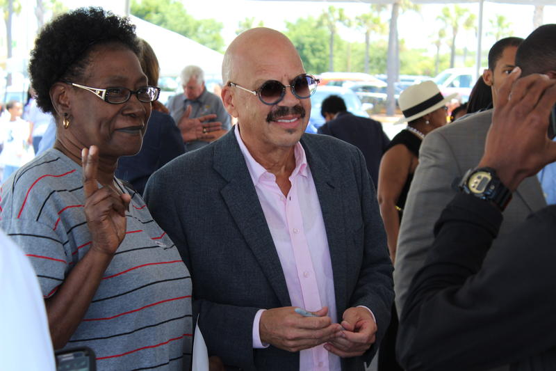 National radio host Tom Joyner greets attendees after the rally.