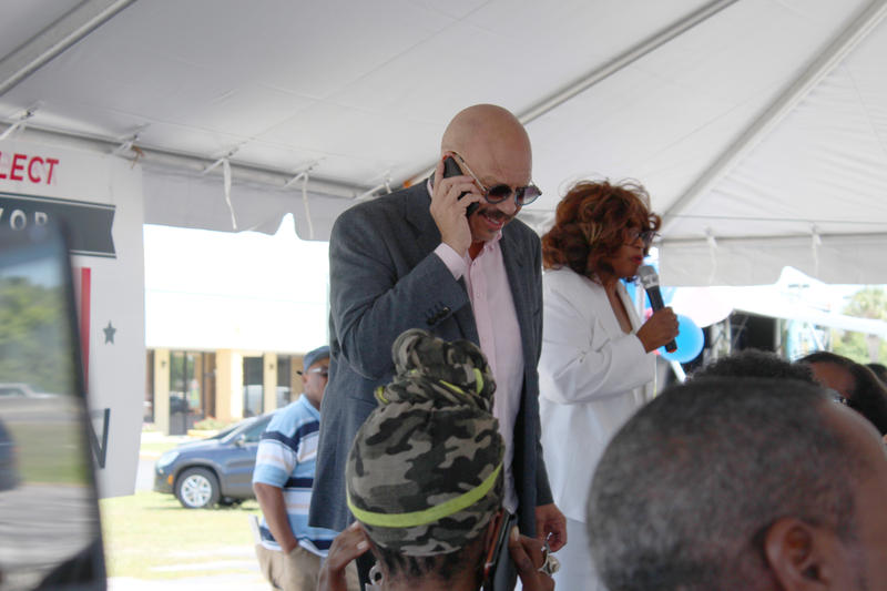 National radio host Tom Joyner calls friends and family of attendees to encourage potential voters to hit the voting booths, while Congresswoman Corrine Brown speaks to the crowd at an early voting rally on Friday.
