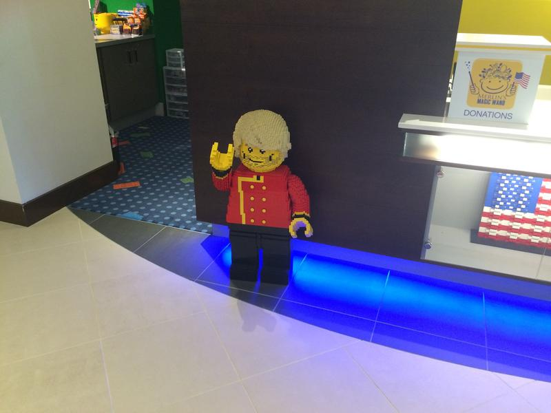 A LEGO bellhop stands ready to take your luggage to your room
