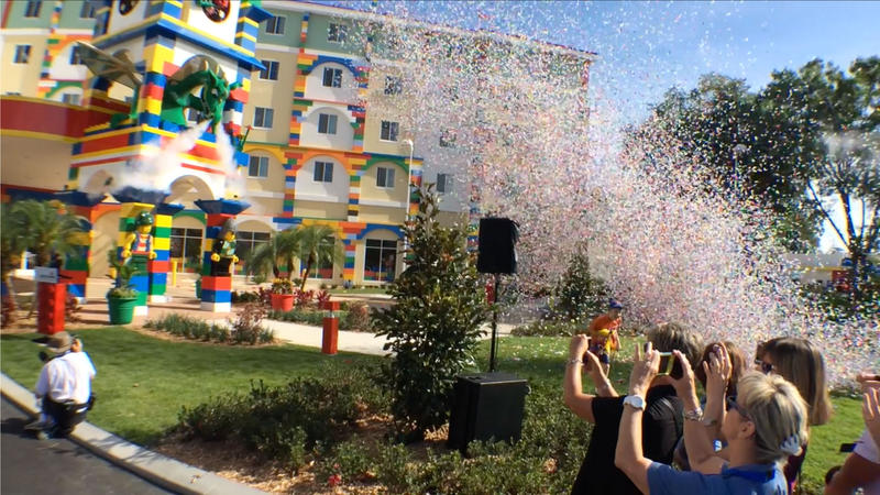 A blast of confetti fills the sky and the LEGO dragon blows smoke at the LEGOLAND Hotel opening ceremony.