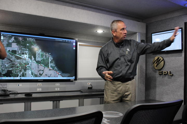Ralph Grant of Florida Power and Light shows off the mobile command center, a truck designed to respond to power outages during disasters.
