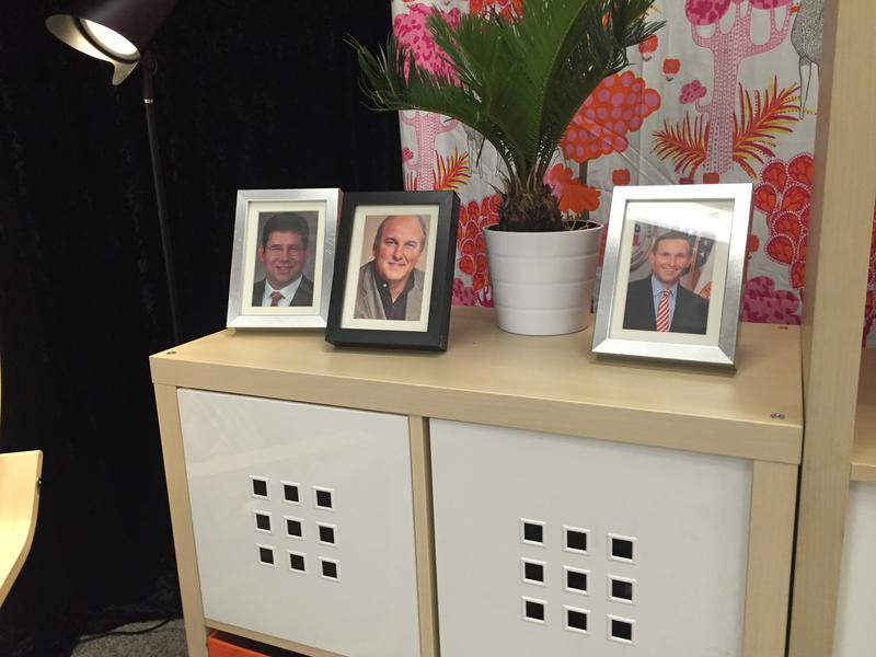 An IKEA dresser with framed pictures of Mayor Lenny Curry, City Council President Greg Anderson and City Councilman Al Bowman perched on top stands near IKEA spokesman Joseph Roth as he announces plans to open an IKEA store in Jacksonville.